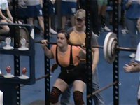 Image: Preparing to squat — Kaytlyn Bales gets ready to execute her lift.