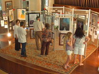 Image: The house was packed — These onlookers were enthralled with Shelly Nance's works of art.