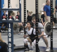 Image: Italy's Marisela Perez competes in the squat — Italy's powerlifter Marisela Perez competes in the squat during the Rice Invitational Powerlifting Meet. Perez earned 2nd place in her class with a total of 405lbs, 165lbs squat, 75lbs bench, and 165lbs deadlift.