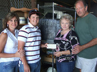 Image: Roy and Hobbs — Roy Glaspy, recent graduate of Italy High School, stands with his mom, Lisa Poarch and Joyce and James Hobbs of Hobbs Feed Store.  Roy is the first recipient of a scholarship from the newest business in town.