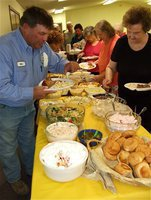 Image: Let's eat! — Precint 3 crew member Brian Mathiowetz joins CBC church members in the lunch line.