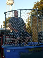 Image: Sitting Pretty! — This is what Milford Police Chief Carlos Phoenix looked like before he got dunked.