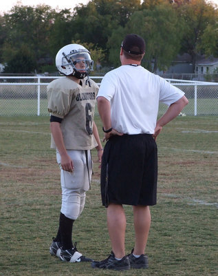 Image: Wooldridge and Coach Ward — Discussing the plays.