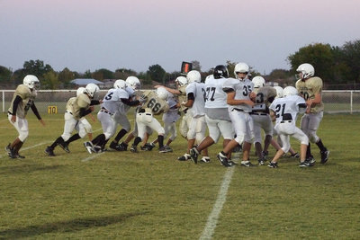 Image: Gladiator defensive line — The Gladiators working hard to defend their goal.