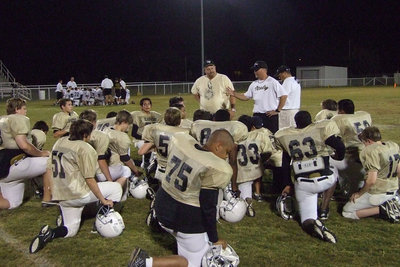 Image: After the game talk — Coach Ward telling the boys they did a good job.
