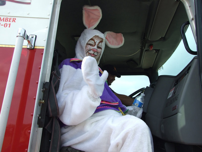 Image: I have to hop now — Before the Fire Department whisked him away, the Easter Bunny has time for a wave goodbye.