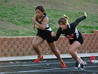 Image: Ashley takes off — Italy's Ashely Harper, on the left, competes in the 100 meter dash and eventually earns 5th place overall in the event.