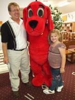 Image: Clifford gives hugs — Gary Clark, Sidney Lowenthal and Clifford the Big Red Dog all having a good time at the book fair.