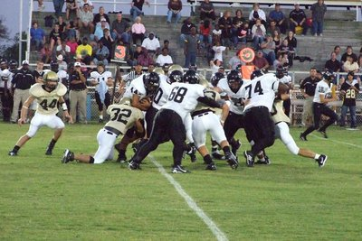 Image: Defense — Malakoff offense tries get through the Gladiators.