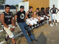 Image: Members of the Gladiator varsity team wait their turn to take on the Waco Reicher Cougars Friday night.