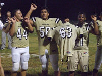 Image: The Gladiators sing their school song as they honor senior #63 Brandon Souder.