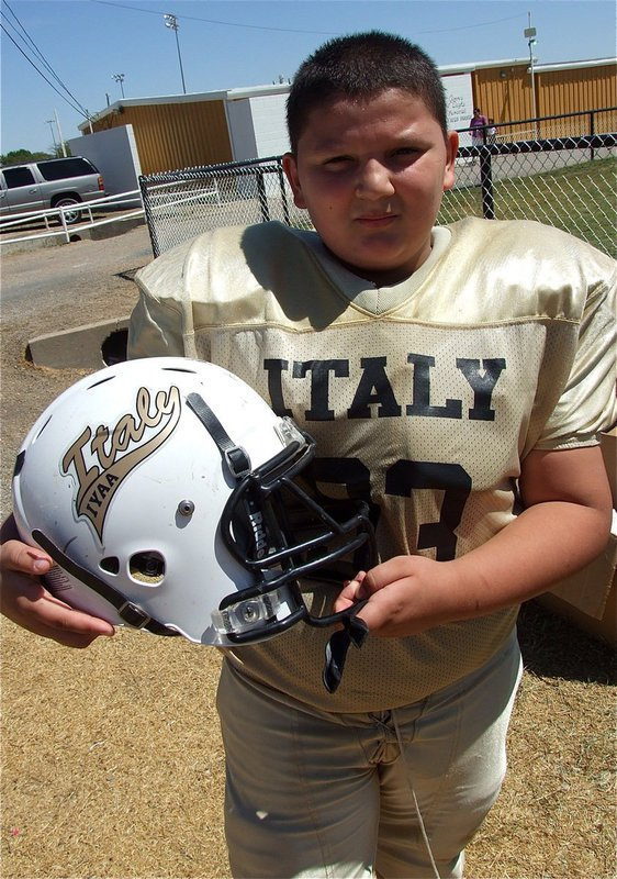 Image: Austin Lowe displays his new helmet and decal after the IYAA A-Team's win over Rice.
