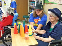Image: All decked out in hats during a therapy lesson.