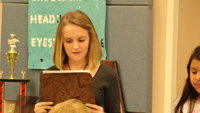 Image: Kirby Nelson reads a poem she learned in sixth grade.