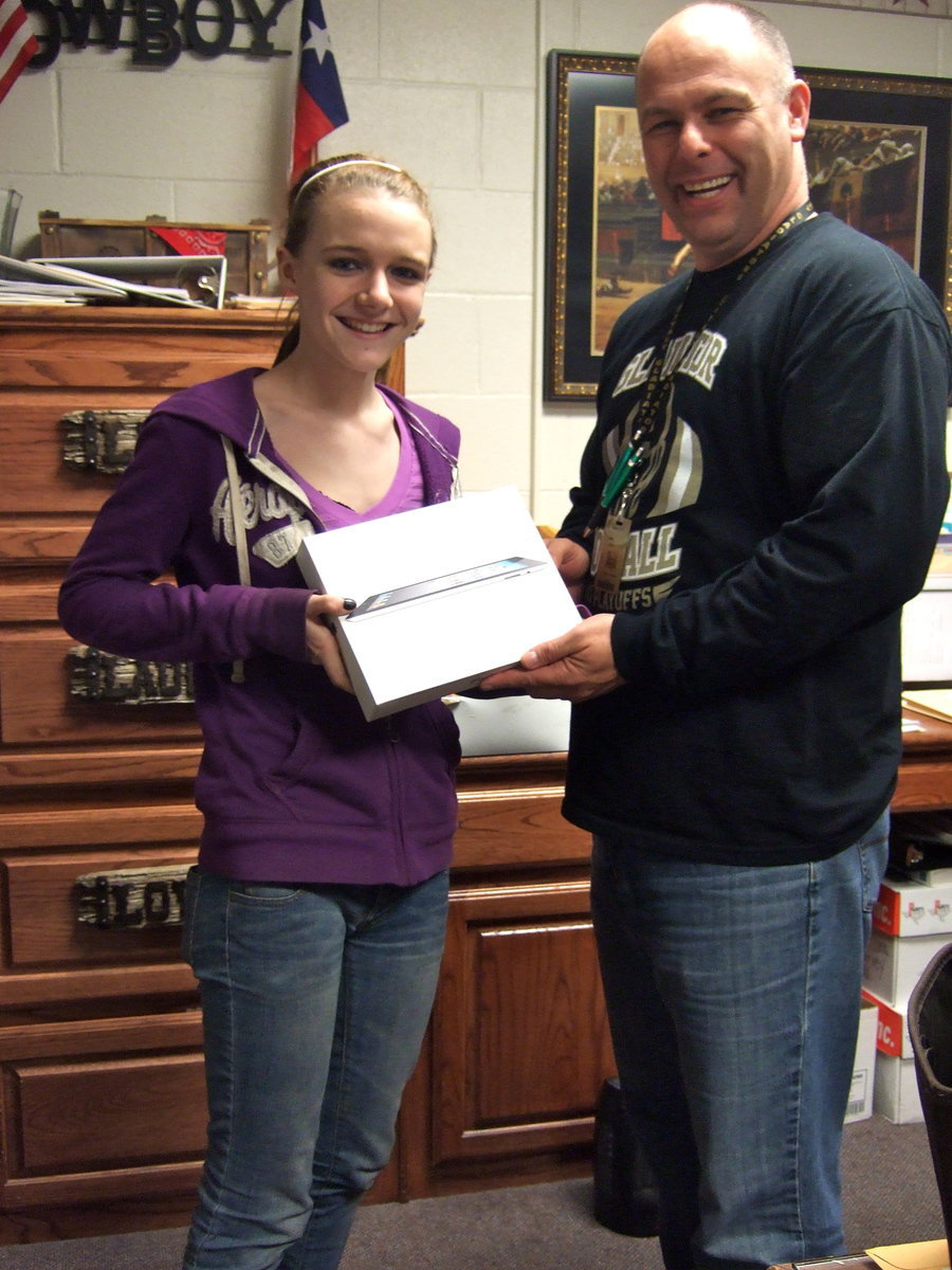 Image: Kayla Cummingham accepting the iPad from Mr. Joffre.