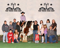 Image: Members of the Flying Dollar Ranch fan club were on hand to pose in the GHRA Reserve World Champion Trail and English win photo. Photo by Larry Williams Photography.