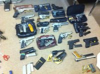 Image: Recovered stolen property including at least 18 loaded handguns and over 100 knives.