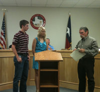 Image: Ross Stiles and Megan Richards receiving $500 scholarships from Jack Bingham, DCI Sanitation manager.