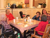 Image: These residents are enjoying the birthday celebration.