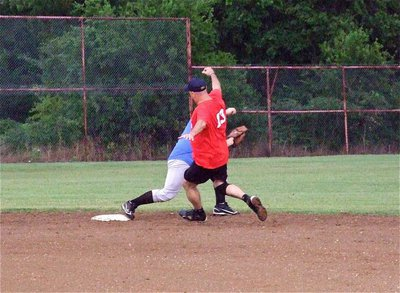Image: I.P.D.'s Robert McFarland keeps Paul Cockerham from reaching second base.