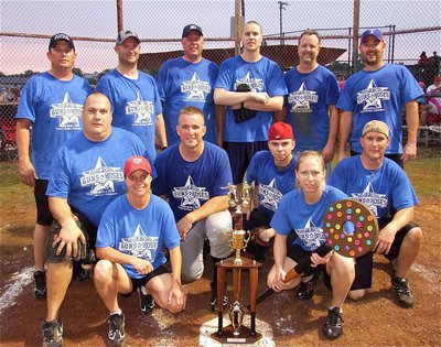 Image: The Italy Police Department poses with the official Guns Vs. Hoses trophy that will travel between departments each year depending on which side wins the game. Back row: DPS Trooper Vance Griffin, Officer Shawn Martin, Chief Diron Hill, Officer Michael Richardson, Citizens Police Academy member Kelly Westbrook, Police Commissioner Rodney Guthrie. Middle row: Ellis County Constable Brad Elliott, Bryan Police Officer Robert McFarland, Officer Daniel Pitts and Criminal Investigator Perry Kaemerling. Bottom row: Sergeant Tierra Mooney, the Guns Vs. Hoses trophy and Officer Shelbee Landon.
