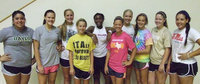 Image: New IHS Volleyball Coach, Jessika Robinson, stands in the middle of a few of the 2012-13 Lady Gladiators, as she watches a voluntary strength and conditioning session with some of her new student/athletes. Coach will meet all the high school girls wanting to play volleyball at try-outs on Aug. 6th.