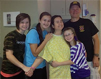Image: Heart transplant recipient Andrea Hooker of Italy pictured with her husband Jerry Hooker and their wonderful daughters Meagan, Amber and Kimberly. Team Hooker is asking for donations to help with the family's medical bills and is holding a silent auction during the home game between Italy and Hubbard on Friday, September 21, at Willis Field starting at 7:30 p.m.