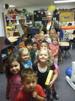 Image: Sue Morrison with her pre-K-3 students.