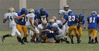 Image: The Italy Junior High defense brings down a Sunnyvale Raider running back.