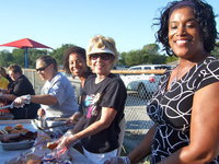 Image: Dedicated teachers, principal and staff working hard at making the family picnic a success.