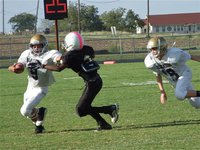 Image: Italy's 7th grade quarterback Tylan Wallace(9) tries to turn the corner against Itasca.