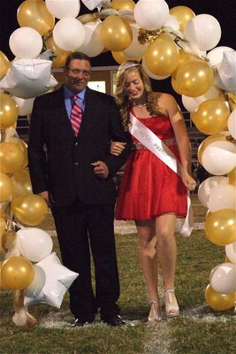 Image: 2012 IHS Homecoming Princess Madison Washington is escorted by her grandfather David McClendon.