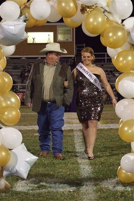 Image: 2012 IHS Homecoming Queen nominee Katie Byers is escorted by her father Brentley Byers.
