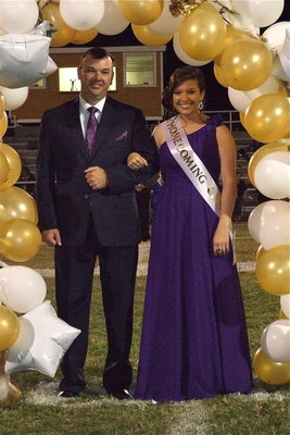Image: 2012 IHS Homecoming Queen nominee Morgan Cockerham is escorted by her father Paul Cockerham.