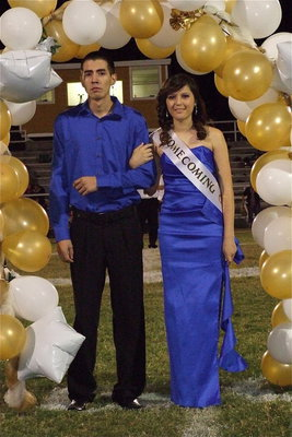 Image: 2012 IHS Homecoming Queen nominee Paola Mata is escorted by her brother Raul Mata.