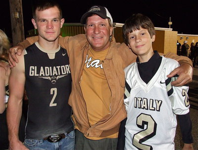 Image: Chase Hamilton(2), with his father Lee Hamilton and younger brother Ty Hamilton who wears his older brother's jersey in his honor but sports #17 when playing for Italy's 7th grade Gladiators.