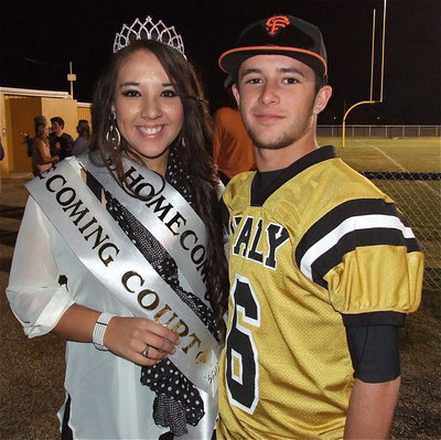 Image: 2012 IHS Homecoming Queen Alyssa Richards is accompanied by Gladiator Caden Jacinto(6) after the game.