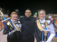 Image: Gladiator Regiment Marching Band director Jesus Perez proudly poses with (L) drum major Emily Stiles and® assistant drum major Madison Washington and their trophies.