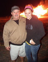 Image: Italy School Board president Larry Eubank with his daughter Bailey Eubank, who is a Lady Gladiator sophomore, enjoy the homecoming bonfire together.