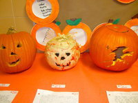 Image: Look at these creative jack-o'-lanterns! Can you see the witch on her broom?