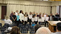 Image: Stafford Elementary choir performs at school board meeting.