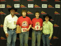 Image: Tristan Smithwick and Brandon Conner have successful catches at the 2013 San Antonio Livestock Show and Rodeo Calf Scramble.