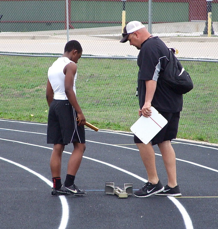Image: Kendrick Norwood receives assistance from Italy's AD/HFC Hank Hollywood.