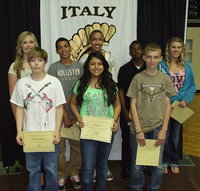 Image: 7th graders Annie Perry, Stockard Smithwick, Tylan Wallace, Noeli Garcia, Emmy Cunningham, Kendrick Norwood, Colton Allen and Sydney Meeks are presented awards during the 2013 Italy Junior High Awards Ceremony held inside Italy Coliseum.
