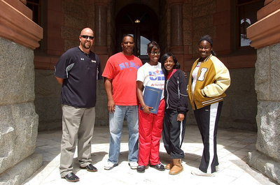 Image: Coach Hank Hollywood, James Johnson and his daughter Kortnei Johnson, Kendra Copeland and Taleyia Wilson stand proud outside the Waxahachie Courthouse after Kortnei received the proclamation in her honor.