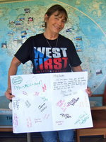 Image: Here is Margie holding up a big 'Thank You' card from her students!