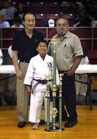 Image: Italy's Nick Sam is pictured with Grand Master Park-Houston and Master Charles Kight-Chief Instructor of the Hillsboro Unified Tae Kwon Do School who present Sam with a trophy that rewards his earning All A's during the 2012-2013 school year as a a student at Italy Stafford Elementary.