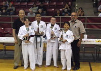 Image: Pictured are Grand Master Park-Houston, Kathryn Drennan-Grandview, Luis Rodriguez-Hillsboro, Michael Russell-Italy, Seo Young Ha-Grandview and Chief Instructor of the Hillsboro TKD School Master Charles Kight as each student receives Best Performance in there division trophies after passing a recent belt test at the Hillsboro Unified Tae Kwon Do School.
