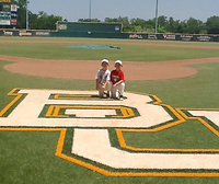 Image: Austin Cate, 7 with friend and teammate Dustin Duke, 7, represented Italy and the IYAA Sports Family (Italy Youth Athletic Association) during a summer baseball camp held at Baylor University. Despite being the youngest campers in attendance, Cate and Duke left their mark on Baylor's baseball field.