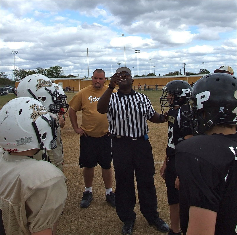 Image: Referee, Robert Hodge, flips the ceremonial coin.